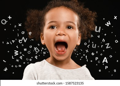Screaming African-American girl and many letters on dark background