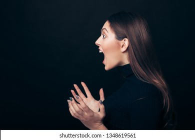 Screaming angry woman profile portrait isolated on black background with copy space. Negative emotions, hate, rage or stress concept