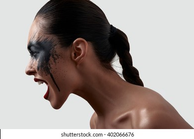 Screaming beauty Model with American Indian Makeup