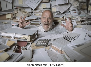 Screaming businessman drowning under a lot of paperwork in the office, he is overwhelmed by work and going insane