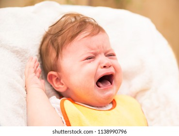 Screaming crying baby on white background. Dealing with children's hysterics concept