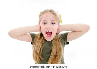 Screaming girl covering her ears, observing. Hear nothing. Human emotions, facial expressions. Isolated on white background