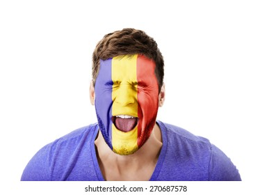 Screaming man with Andora flag painted on face.