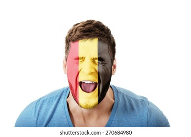 Screaming man with Belgium flag painted on face.