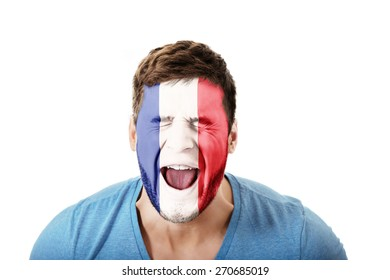 Screaming man with France flag painted on face.