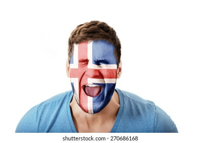 Screaming man with Iceland flag painted on face.