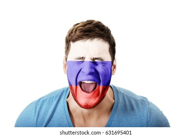 Screaming man with Russia flag on face.