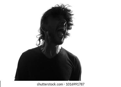 Screaming man silhouette,back lit