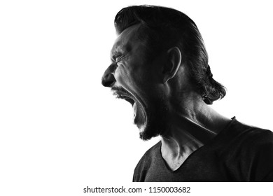Screaming mle person silhouette,back lit light