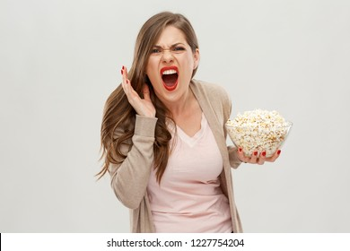 Screaming scared woman holding popcorn. Horor movie concept portrait.