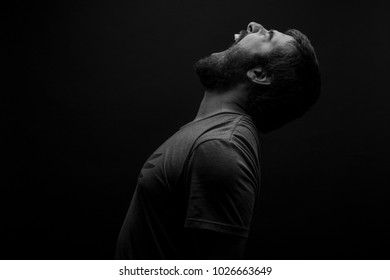 Screaming and Shouting Young Man looking at the sky