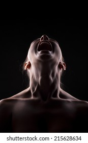 screaming unknown woman with the face in the shadow