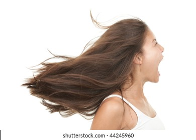 Screaming woman. Angry and upset beautiful young mixed race chinese / caucasian woman in profile. Isolated on white background