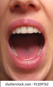 Screaming woman mouth closeup