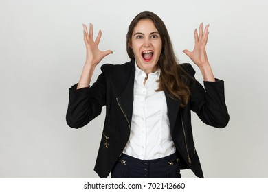 Screaming young businesswoman over gray background