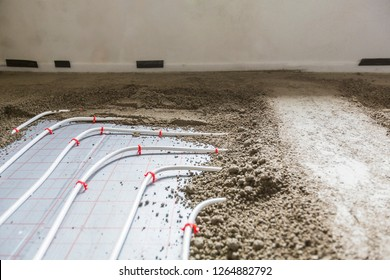 Screed flooring. Worker at a construction site screed floor.