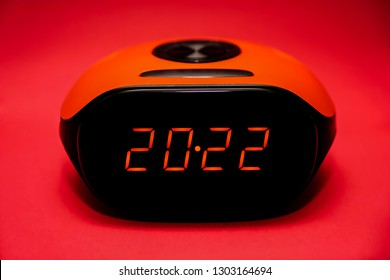 screen of electronic alarm clock - 2022 numbers on black screen. idea of happy 2022 new year and merry christmas. red digits.