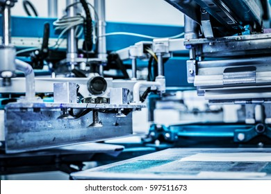 Screen printing machine. Metal industrial machinery.
