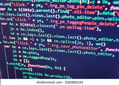 Screen of web developing javascript code. Writing programming code on laptop. Vivid colors. Programmer occupation job. Creative focus effect. PHP data source file. Developer occupation work photo.