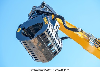 Screening bucket of a construction equipment with blue sky as the background