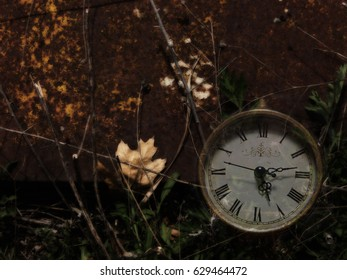Screensaver background with antique clock against rust and leaves