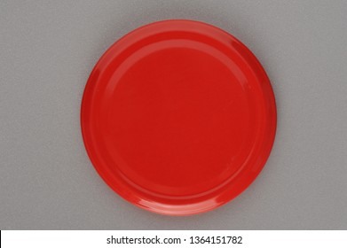 Screw cap for glass jars. For canning, canned food. Red cap on gray background