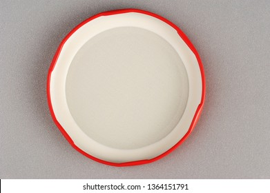 Screw cap for glass jars. For canning, canned food. Red cap on gray background flip cover
