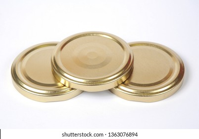 Screw caps for glass jars. For canning, canned food. Golden caps on white background