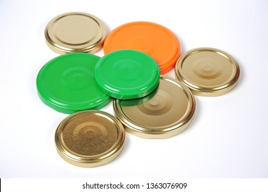 Screw caps for glass jars. For canning, canned food. Orange, green, golden caps on white background