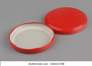 Screw caps for glass jars. For canning, canned food. Red caps on gray background