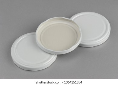Screw caps for glass jars. For canning, canned food. White caps on gray background