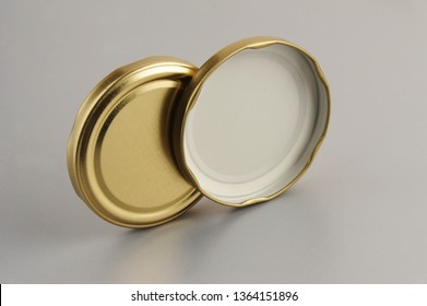 Screw caps for glass jars. For canning, canned food. Golden caps on gray background