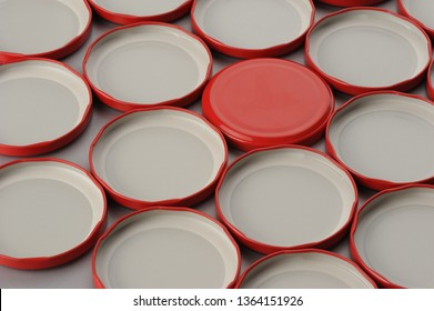 Screw caps for glass jars. For canning, canned food. Red caps on gray background flip covers