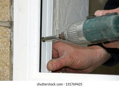Screw fixing to uPVC window installation