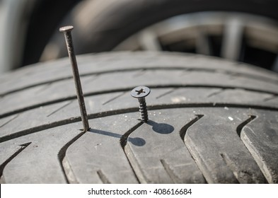 screw puncturing tire