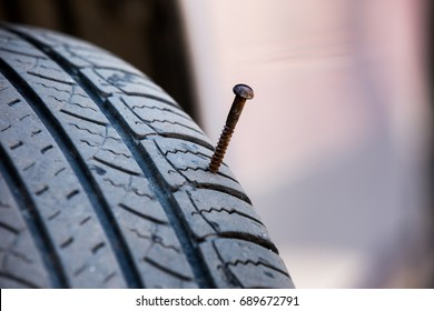 The screw puncturing tire close up