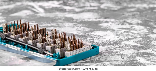 Screwdriver attachments close-up. Power tool. A set of nozzles on the screwdriver - Shutterstock ID 1295755738
