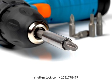 screwdriver bit fixed in drilling machine chuck, macro, shallow depth of field