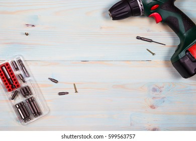 Screwdriver on wooden background.