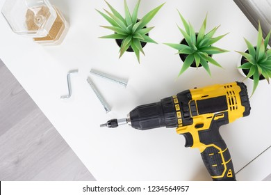 Screwing furniture at home with cordless screwdriver / assembling furniture at home