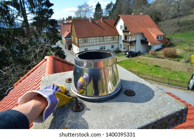 Screwing on the Chimney Cover Plate with approval Seal by a Allen Screw Wrench