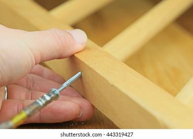 Screwing a screw