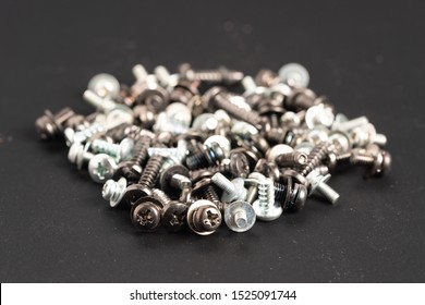 Screws and bolts fasteners industrial black background