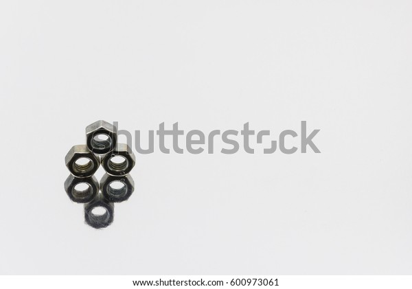 screws and nuts on silver background