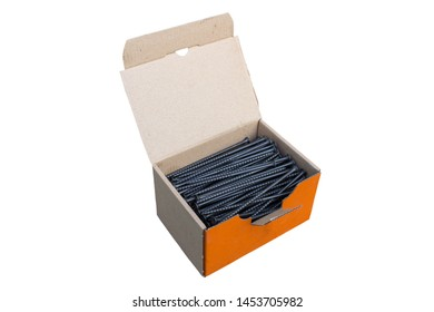 screws for wood in a box,Black screws in a box of cardboard isolated on a white background