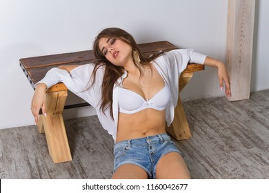 Scripted crime scene - young woman in bra sitting on the ground unconscious or dead