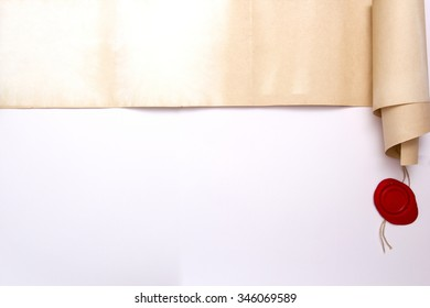 Scroll of ancient parchment with wax seal on a white background.
