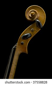 scroll and pegs of old violin isolated on black