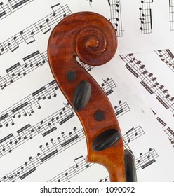 The scroll of the violin in profile, showing beautiful curves.