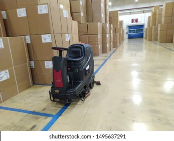 Scrubber drier for cleaning storage facilities.  Close-up.Floor polisher.Floor cleaning machine. Floor maintenance.